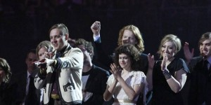 Arcade Fire react after winning best International Album during the BRIT music awards at the O2 Arena in London