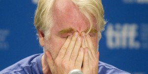 "Actor Phillip Seymour Hoffman reacts at the news conference for the film ""Moneyball"" at the 36th Toronto International Film Festival"